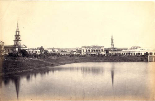 St. Andrew's Kirk (1818) and Kiernander's Old Mission Church (1770) reflected in the waters of Lal Dighi, at a yet unverified date, sometime before June 1897.
